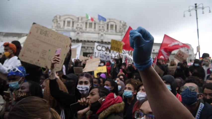 Milan, Italy - June 7, 2020: protesters of the 'Black Lives Matter' movement gather to protest against racism and police brutality following George Floyd's death in Minneapolis, USA.