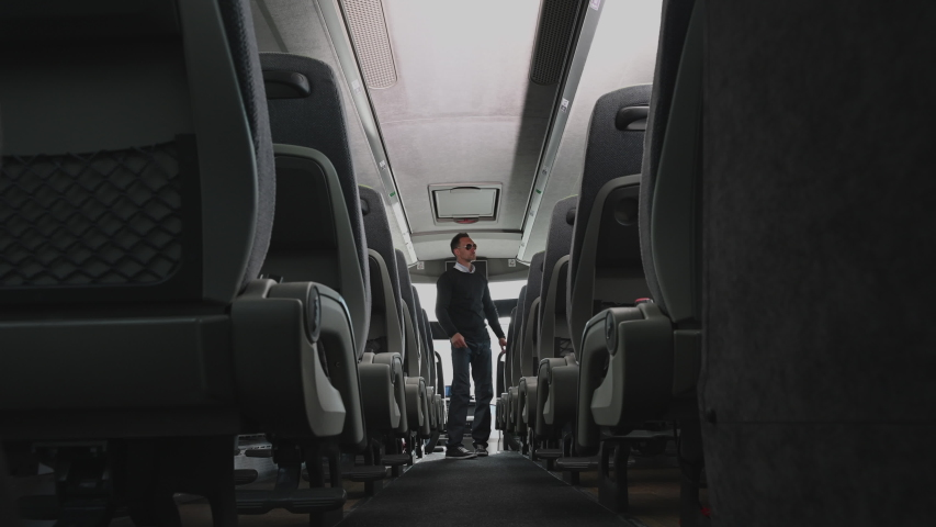 Coach Bus Operator Checking Aisle Seats And Storage Compartments After Passengers Left Vehicle. | Shutterstock HD Video #1053936818
