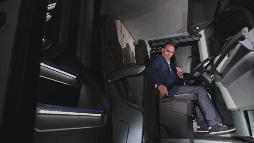 Private Coach Operator Dressed In Suit Entering Bus Sitting Down In Cabin And Fastening Seat Belts. | Shutterstock HD Video #1053936833