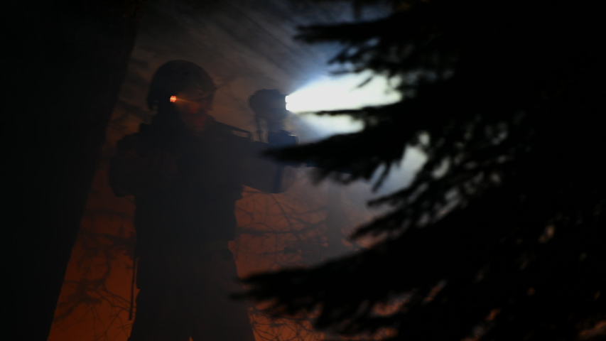 Male Soldier With Flood Light And Machine Gun With Laser Walking In Dark Wooden Area At Night Searching For Enemy. | Shutterstock HD Video #1053936857