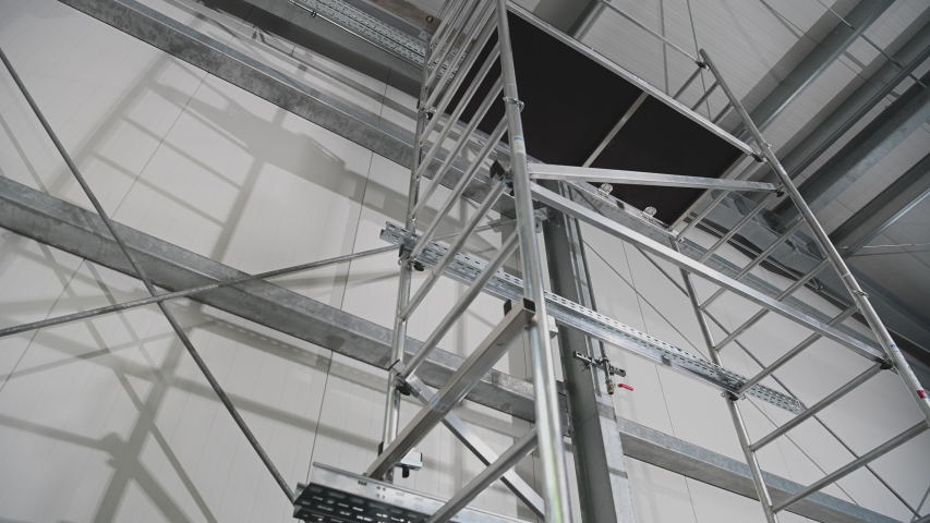 View Of Tall Metal Scaffold Structure On Interior Construction Job Site. | Shutterstock HD Video #1053936872
