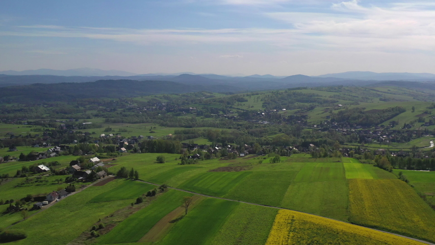 Aerial View Of Endless Farmlands And Beautiful Countryside With Yellow And Green Fields And Meadows In Rural Area. | Shutterstock HD Video #1053936899