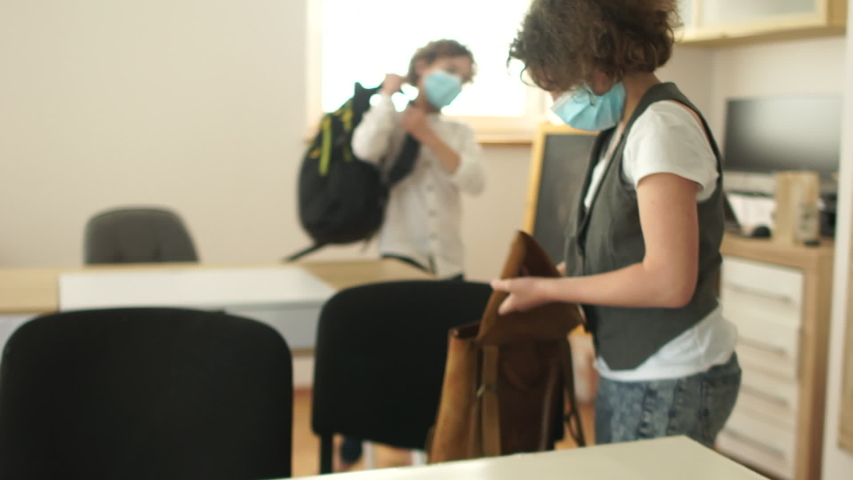Studying in schools after quarantine. Back to school. Masked children leave the classroom after the lesson. Social distance, new normality Royalty-Free Stock Footage #1053938819