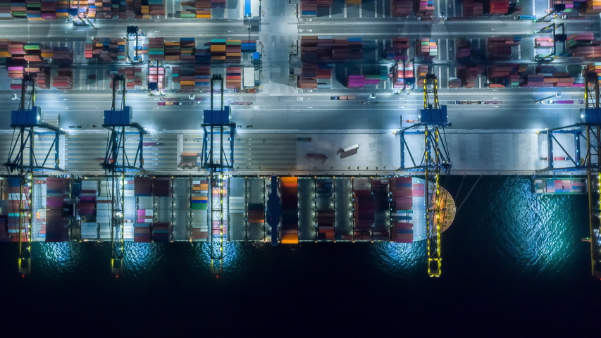 Time lapse Container , container ship in export and import business and logistics. Shipping cargo to harbor by crane. Water transport International. Aerial view and top view. | Shutterstock HD Video #1053949817