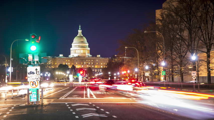 Time-lapse of evening rush hour traffic racing around the United States Capitol Building in Washington, DC.