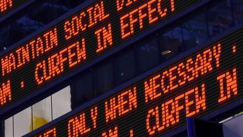 A Times Square news ticker scrolls the reminder message. Curfew in Effect from 9 pm to 6 am. Custom messages available upon request. | Shutterstock HD Video #1053958307