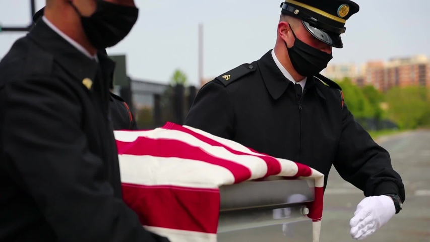 CIRCA 2020 - Soldiers at Joint Base Myer-Henderson Hall in Virginia conduct military funeral during the COVID-19 pandemic coronavirus outbreak.
