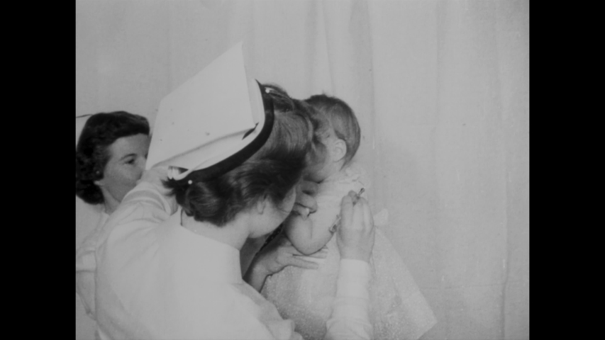 CIRCA 1955 - Nurses and doctors administer polio vaccine shots to young children.