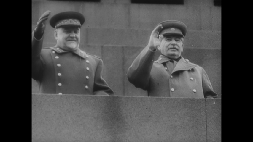 CIRCA 1953 - Joseph Stalin waves from the balcony of a tall building in Moscow, Russia.