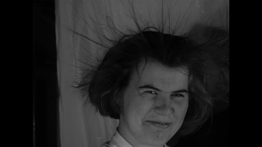 CIRCA 1939 - At the Oregon Institute of Technology, an instructor demonstrates the power of a generator with voltage high enough to raise hair.