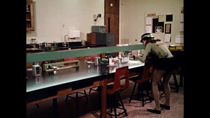 CIRCA 1960s - A girl tampers with her science classes safety gear in order to make it less safe�