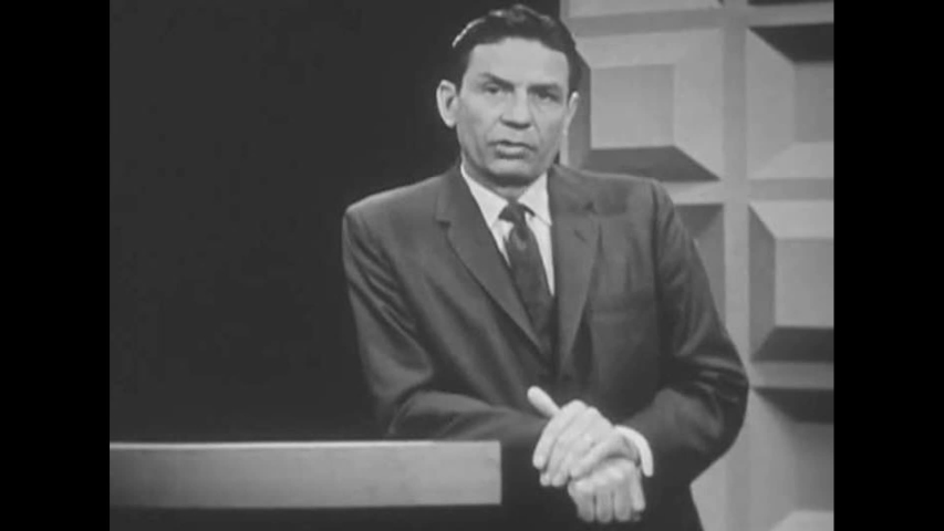 CIRCA 1960s - A presenter explains procedures for the emergence from a fallout shelter in a potentially radioactive environment, in 1963.