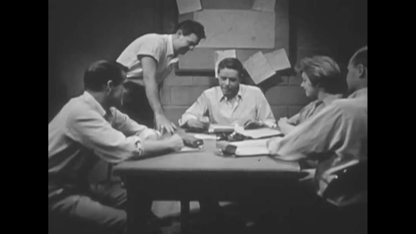 CIRCA 1960s - Occupants of a fallout shelter have a meeting, in 1963.