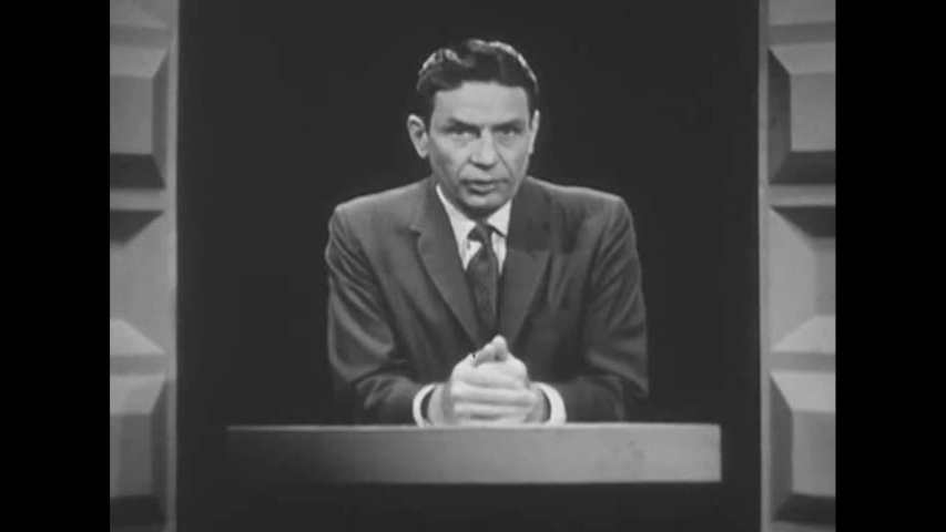 CIRCA 1960s - A map of a fallout shelter is explained by a presenter, in a studio, in 1963.