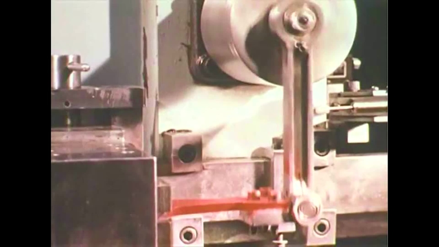 CIRCA 1970s - Designers work on plans and automotive components are tested in laboratories, in 1970.