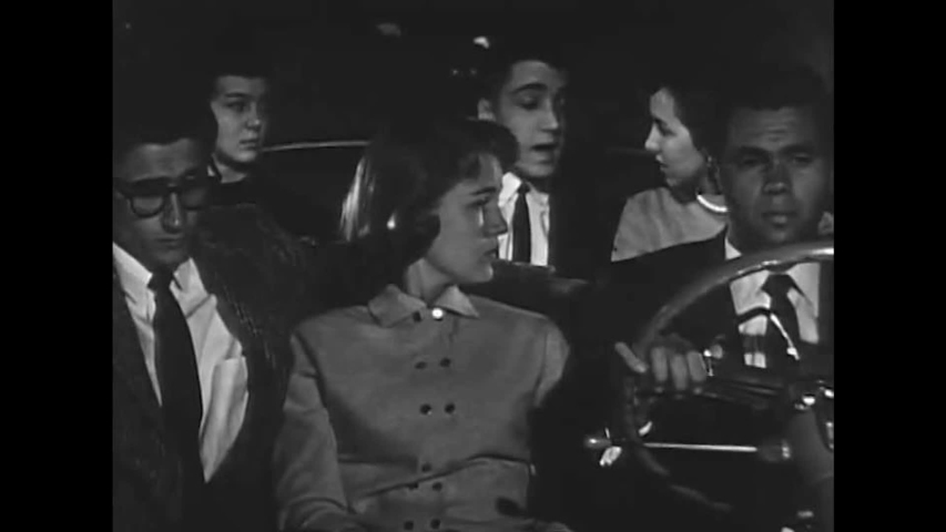 CIRCA 1950s - Students discuss their unfair prejudice against a classmate while on their way to visit him in the hospital in the 1950s.