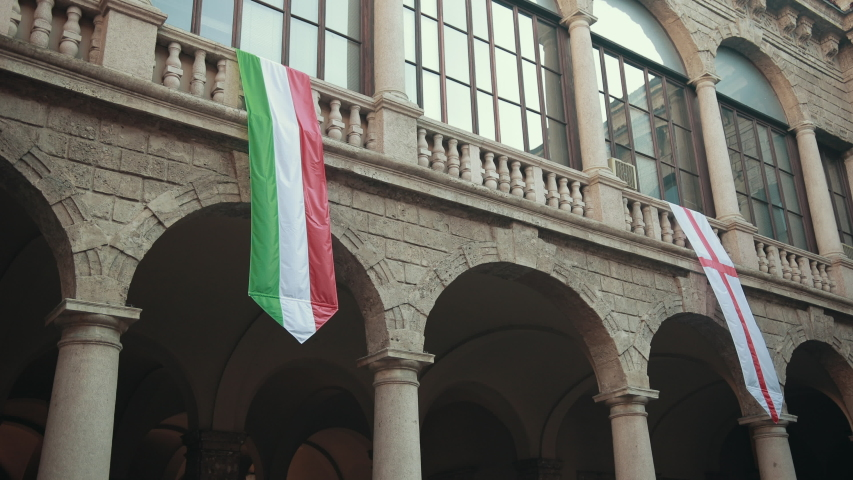 Two Long Flags Hang From Window Sill House Italian And The Symbol Of Lombardy In Milan | Shutterstock HD Video #1053973019