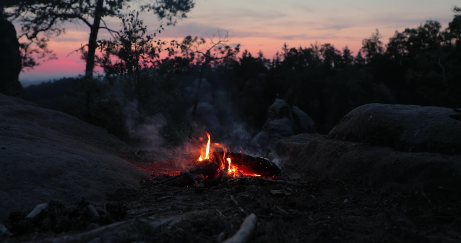 Camp fire burning on a mountain on midsummer night | Shutterstock HD Video #1053978224