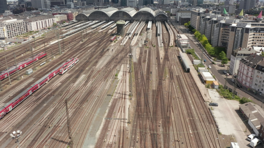 AERIAL: Forward Flight over Frankfurt am Main, Germany Central Train Station Train Tracks on beautiful Summer Day with little Traffic due to Coronavirus Covid 19 Pandemic in June 2020