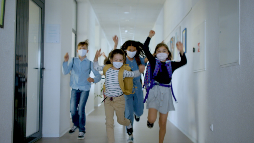 Group of cheerful children going home from school after covid-19 quarantine and lockdown.   Shutterstock HD Video #1053984830