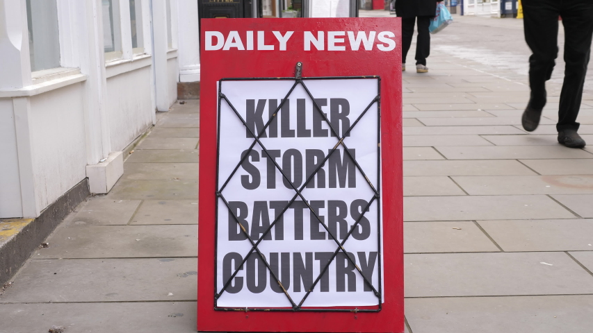 4K: Newspaper Headline Board about a bad Storm and bad Weather - News stand. Stock Video Clip Footage | Shutterstock HD Video #1053998657