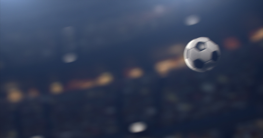 A ball flying on the 3d made professional soccer stadium with animated crowd.