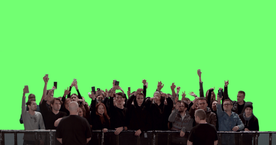 GREEN SCREEN CHROMA KEY Model released, Front view of a crowd dancing and cheering at a concert or a show behind control barrier. Shot on RED Helium 8K Prores 4444 | Shutterstock HD Video #1054006376