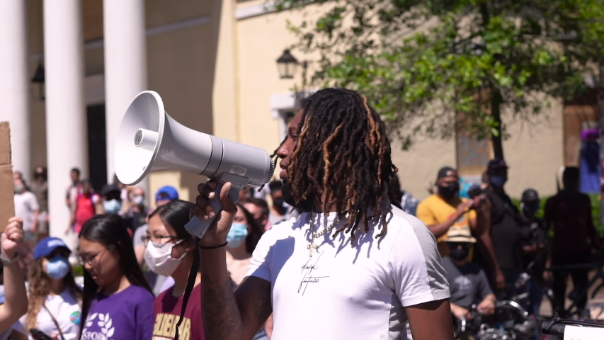 Washington D.C./USA- June 7th 2020: A Black Lives Matter organizer leading protesters on a March through the streets of Washington D.C. with a microphone.