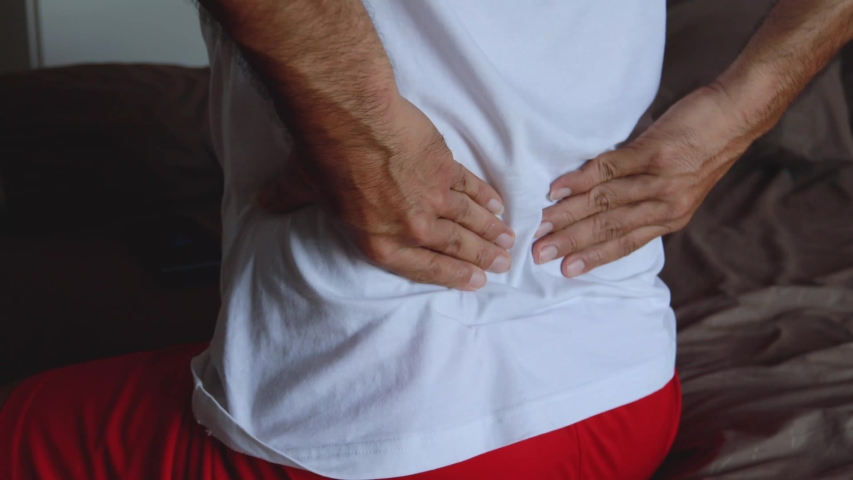 Close up man with low back pain Royalty-Free Stock Footage #1054014740