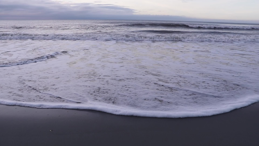Wide angle view ocean tide and waves. Slow motion.