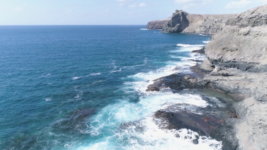 Areal slow motion drone shot of coastline of Canary Islands in Gran Canaria