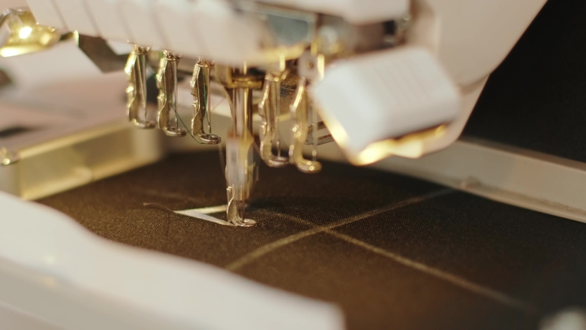 The automatic embroidery machine is working at high speed. Close-up | Shutterstock HD Video #1054030400