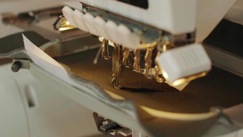 The automatic embroidery machine is working at high speed. Close-up | Shutterstock HD Video #1054030406