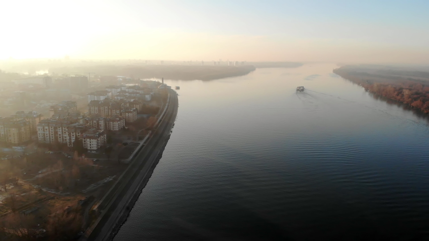 Aerial view of Danube river at sunset, Belgrade, Serbia. Mist and haze in the air. | Shutterstock HD Video #1054031579
