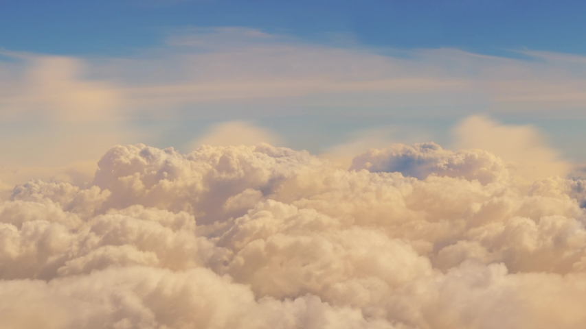 Aerial view of charter private jet flying above white clouds in the sunset light, 3d render Royalty-Free Stock Footage #1054032320