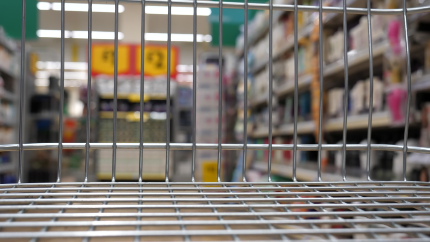 Pushing empty shopping trolley along toiletries aisle in supermarket; shopping cart point of view, POV. | Shutterstock HD Video #1054034699