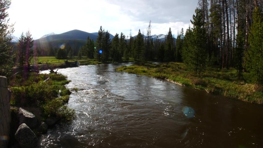 Landscape view of the Colorado River running through Kawuneeche Valley in Rocky Mountain National Park (Colorado).