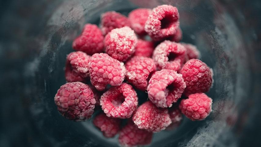 A pile of frozen raspberries is quickly defrosted in a glass. Healthy food. 4K timelapse | Shutterstock HD Video #1054045124