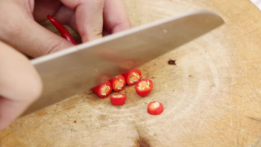 Sliced red peppers on a wooden chopping board | Shutterstock HD Video #1054045595