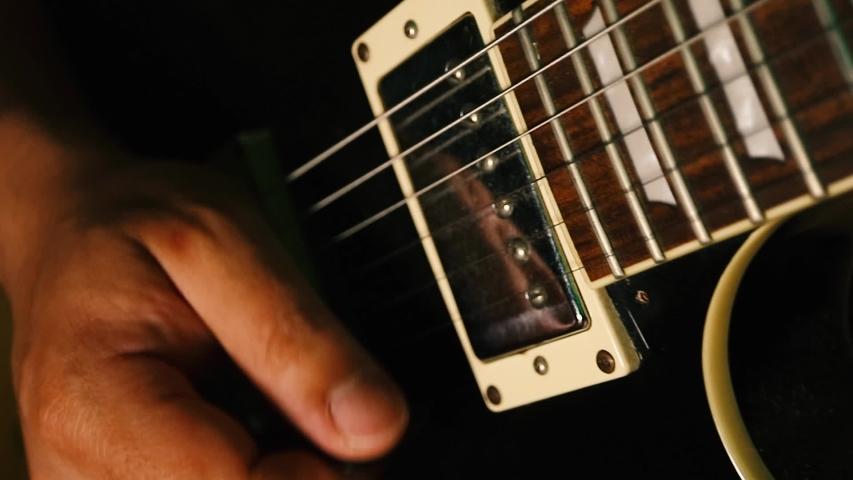 Les Paul guitar played in close up