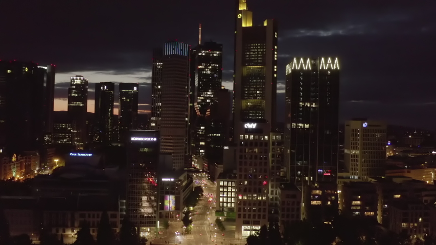 AERIAL: Close Establishing Shot of Frankfurt am Main, Germany Skyline at Night with City Lights and little traffic