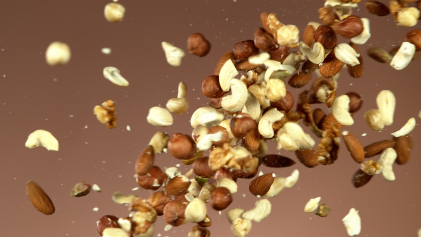 Super slow motion of flying mix nuts collision. Filmed on high speed cinema camera, 1000 fps.