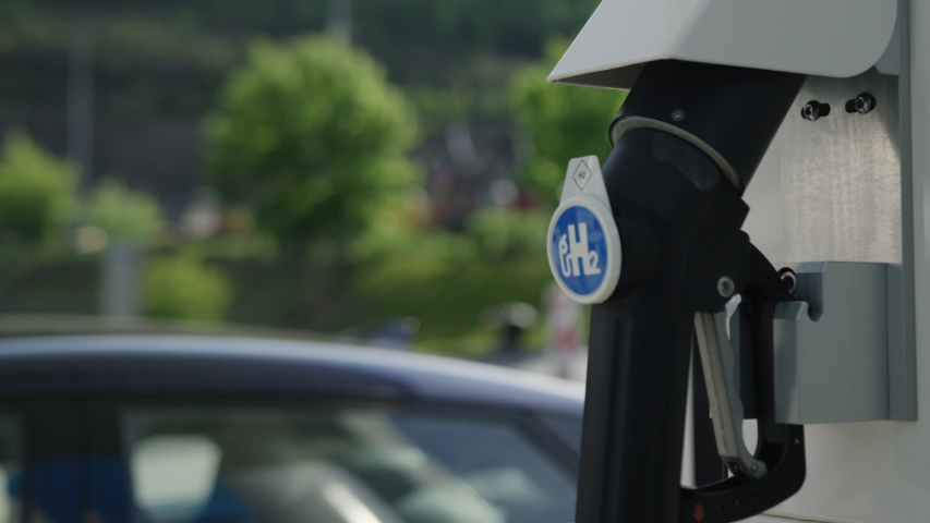 Hydrogen Pump at gas station with hydrogen car in background Royalty-Free Stock Footage #1054060313