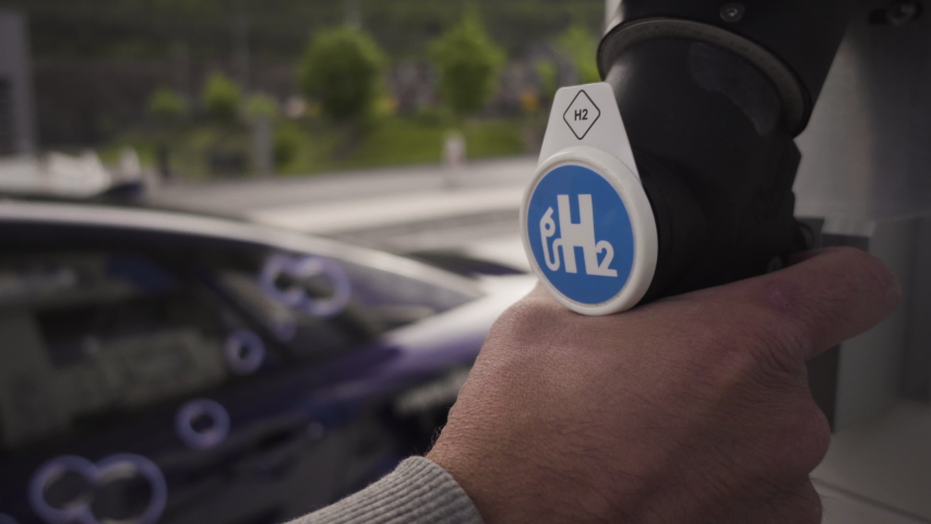 Hydrogen car is being refueled at hydrogen gas station Royalty-Free Stock Footage #1054060775