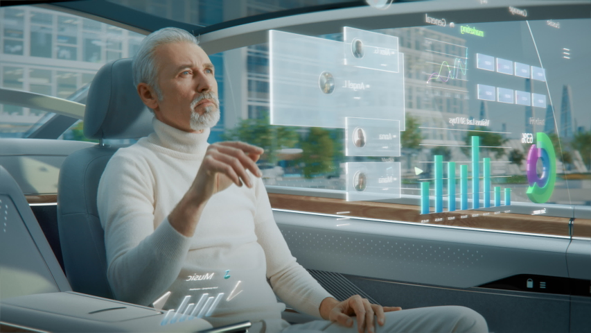 Futuristic Concept: Handsome Stylish Man Using Futuristic Augmented Reality Interface for Reading News and Checking Social Activity while Sitting on a Backseat of Autonomous  Self-Driving Car.  Royalty-Free Stock Footage #1054062317