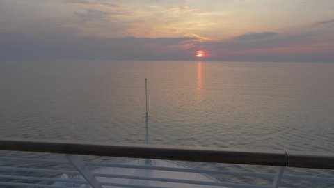 Sun setting on the Adriatic Sea viewed from cruise ship, Split, Dalmatian Coast, Croatia, Europe