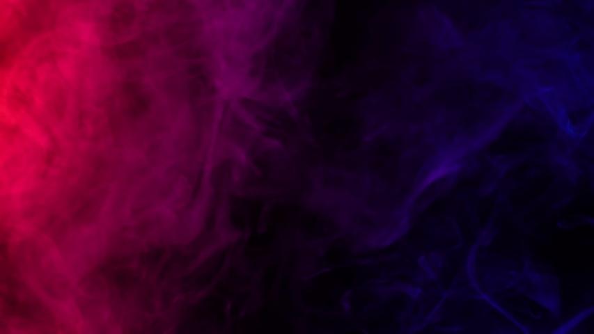 Smoke on a black background. Bright colorful smoke. Blue, raspberry, red, purple background. Beautiful abstract background. smoke texture. Pattern.