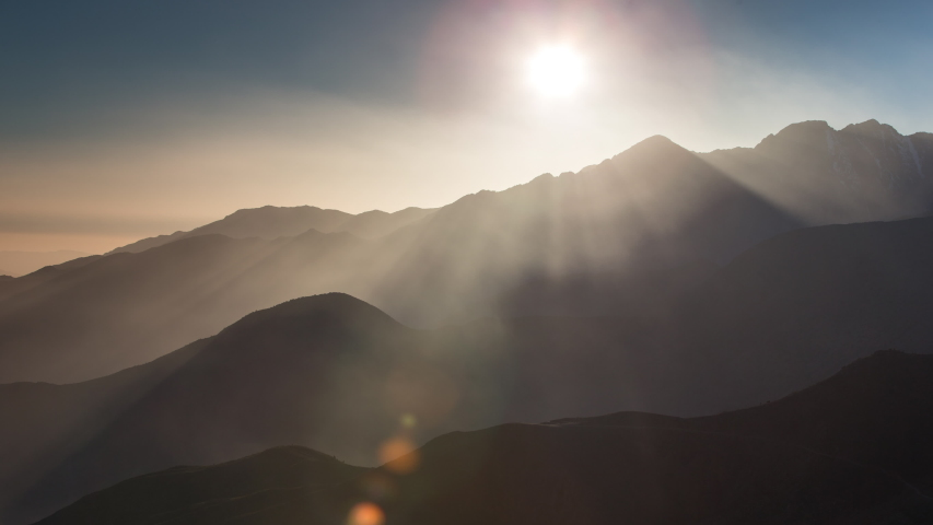 Boomerang style looping gif video of sun moving over the mountains simulating sunrise and sunset Royalty-Free Stock Footage #1054075637