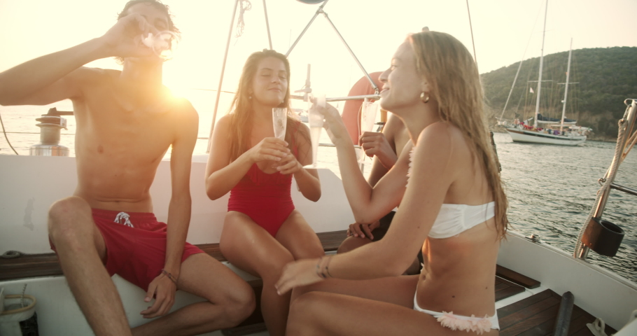 Group of young friends enjoying trip on a sailboat in the Ligurian Sea,