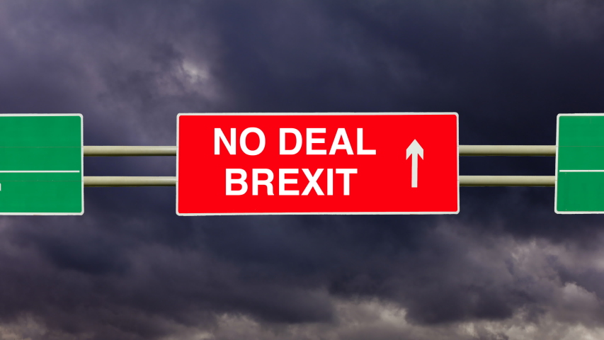 No Deal Brexit on a road sign with an arrow pointing the way to no agreement. Stormy sky and timelapse dark clouds. A deal for the exit of the United Kingdom the UK from the European Union the EU.  | Shutterstock HD Video #1054089140